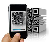 Mobile phone scanning a tridimensional barcode - stock photo