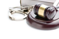 handcuffs and judge gavel - stock photo