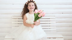 Little girl and flower basket on pink Stock Footage