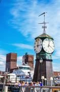 Clock on Aker Brygge Dock, modern part of Oslo - stock photo