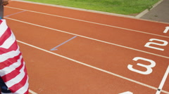 4K Group of athletes (disabled & able bodied) celebrate victory on running track - stock footage