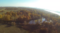 POV flight   over yellow river coastline  .Aerial  shot like birds view, autumn  Stock Footage