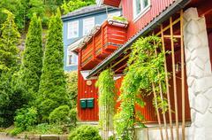 Beautiful red wooden villa in Scandinavia - stock photo