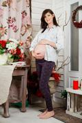 Attractive future mother at home Stock Photos