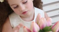 Little girl and flower basket on pink - handheld shot, closeup Stock Footage