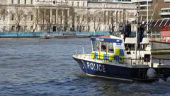 A British police boat patrols the river Thames Stock Footage
