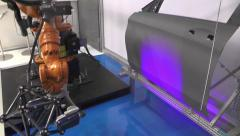 Industrial Robot performing a 3D Scan of a Door - stock footage