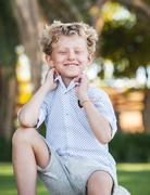Smiling blonde boy portrait - stock photo