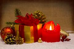 Advent candle and christmas decoration. Stock Photos