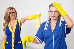 Stock Photo of two different cleaners compete. poor staff