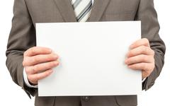 Businessman holding blank paper in hands Stock Photos