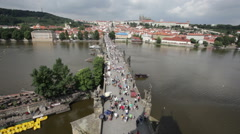 Crowded The Charles Bridge and Vltava river shore Stock Footage