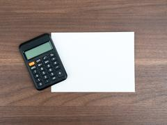 Blank card with calculator Stock Photos