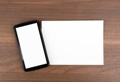 Blank card with smartphone Stock Photos