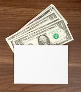 Blank card with cash - stock photo