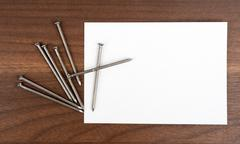 Blank card with nails Stock Photos