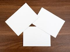 Three blank cards on wood table Stock Photos