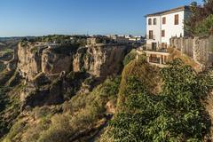 Houses on the cliff edge at Ronda, Spain Stock Photos