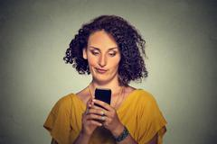upset skeptical unhappy serious woman talking texting on phone - stock photo