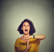 Young woman showing time out hand gesture, frustrated screaming Stock Photos