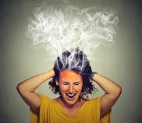 stressed woman screaming frustrated thinking too hard steam coming out of hea - stock photo