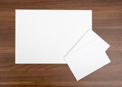 Several blank cards on wood table Stock Photos