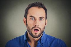 Surprise astonished man. Closeup portrait man looking surprised in full disbe Stock Photos