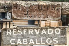 "Rustic ""Reserved for Horses"" parking sign Stock Photos"