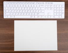 Blank card with keyboard - stock photo