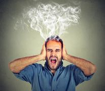 Stressed man screaming frustrated overwhelmed steam coming out up of head Stock Photos