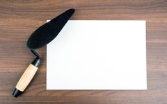 Blank card with palette-knife - stock photo