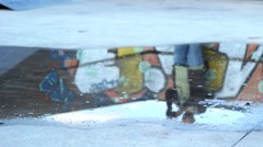 Urban grafitti reflection on water pond court roller  - stock footage