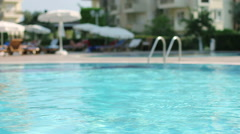 Swimming Pool. Hotel, Summer, Vacation, Sport, Waves, Umbrella, Tourism, Travel Stock Footage