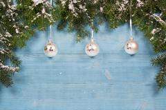 Old planks adorned with twigs Christmas tree and baubles - stock photo