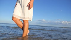 Young Woman Walking on Summer Beach at Sunset Stock Footage