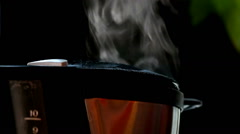Looping cinemagraph photo of steam rising from a coffee maker Stock Footage