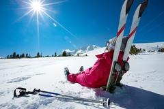 Stock Photo of Skier relaxing at sunny day on winter season