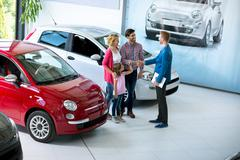 Stock Photo of Family in at car dealership saloon