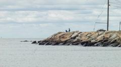 Lone Fisherman, New England Coastline in Summer, jetty Stock Footage