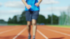 4K Athlete gets into position at running track starting line before a race - stock footage