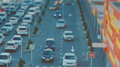 TILT-SHIFT. Parking for cars in front of the Mall - stock footage