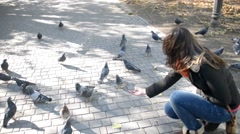 Flock Of Pigeons Doves In Town - little boy runs Stock Footage