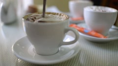 The spoon at the cup of coffee cappuccino Stock Footage