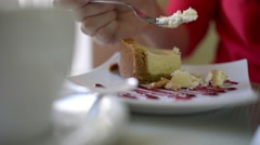 Woman eating cake at the mall cafe - close shot Stock Footage