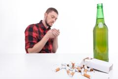 Attractive guy do not worry about his health - stock photo