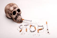 Bad nicotine is killing you every minute - stock photo