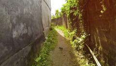 Abstract Timelapse Clip of Passage along a Narrow Rural Alleyway - stock footage