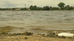 Waves on the city Beach. Slowmotion shot (96 fps) Stock Footage
