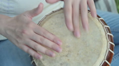 Women playing on Jambe Drum on nature - stock footage