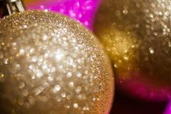 Golden christmas ball on glitter background - stock photo